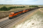 BNSF 5973 attacks the sand hills with a loaded eastbound coal train