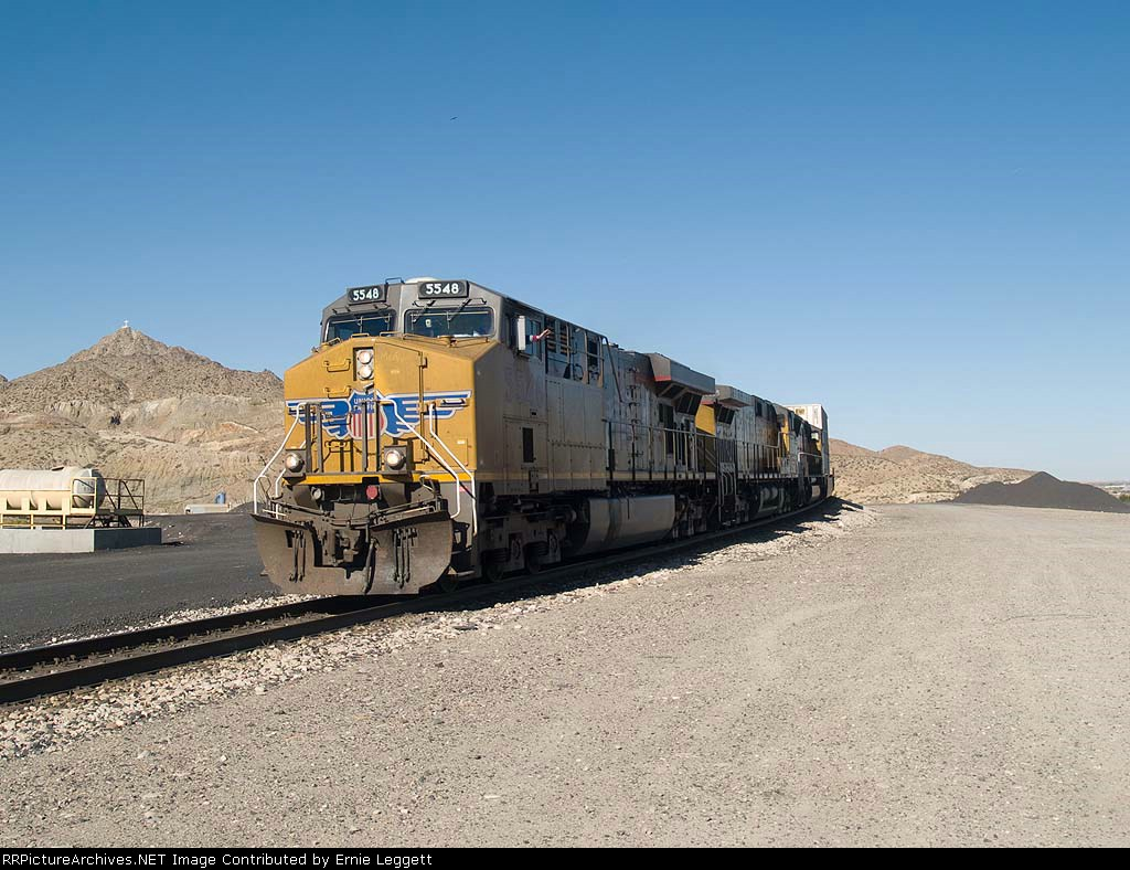 UP 5548 waves and leads an EB doublestack Z-train at 9:19am
