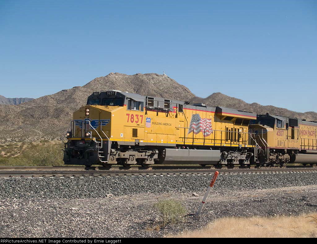 UP 7837 leads a WB autorack/doublestack at 11:11am