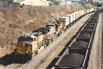 Westbound Z train passes UP coal loads
