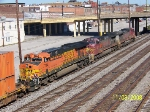 BNSF 7714 trails two warbonnets