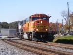 BNSF 8985 leads a loaded Scherer coal train through town