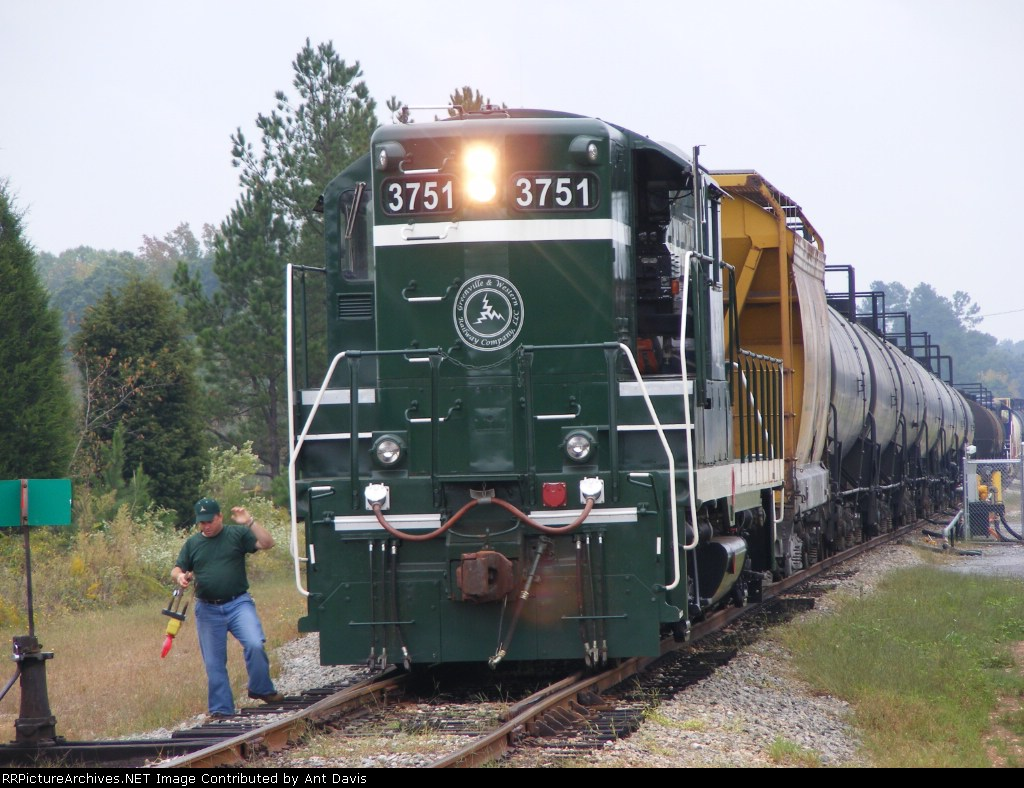 Mr. Schimm leaving the FRED for the Conductor to put on the last car of the train