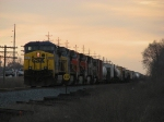 CSX, BNSF & SOO power wait with Q326-30 under the evening cloudy sky