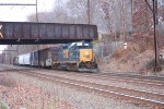 In fading lite, CSX Local 770 reverses toward the station and the yard crossing under the NS