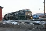"An NS empty hopper train awaits a new crew at ""QD"" before heading west"