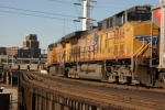 UP 6066 cools its heels as it waits for an eastbound BNSF coal drag