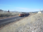 BNSF 5850 leads eb coal nearing the Highway 85 bridge