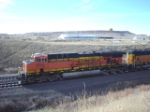 BNSF 5850 is about to pass under Highway 85