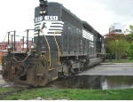 NS 1651 crosses West Main St. leaving Dan River Mills with 3 empty coal cars