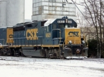 CSX 6921 works on building a train in the snow on the Memphis Line just south of the yard 1/28/09