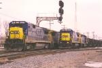 Northbound autoracks pass coal loads