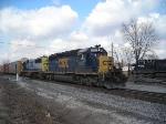 CSX 8112 rolls by NS 9589