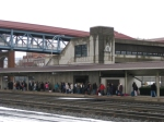 A large crowd of passengers waiting at the Altoona Amtrak station platform