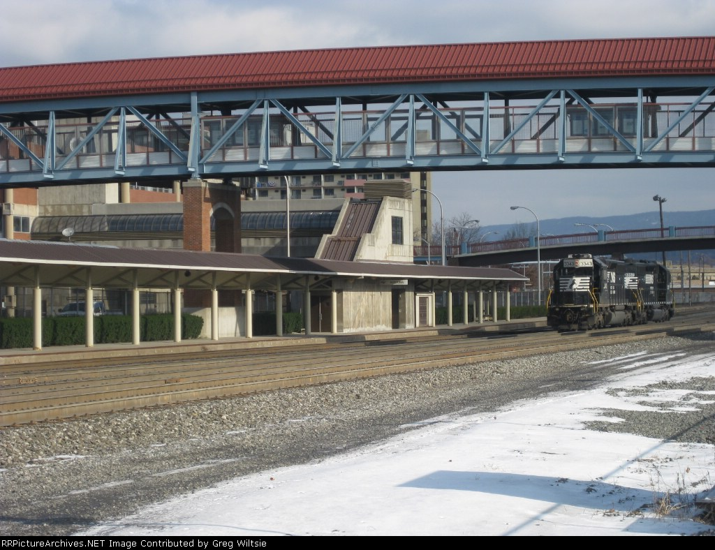 NS 3343 heads past the Amtrak station