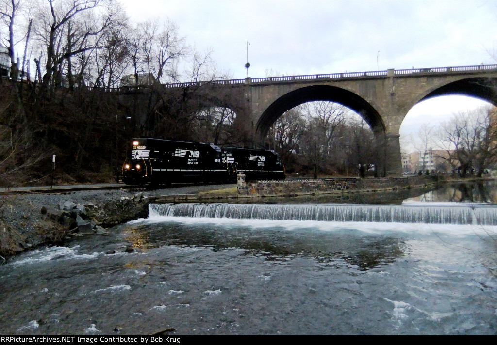 Alongside Monocacy Creek and under the Broad Street arch  bridge
