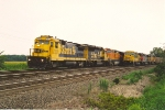 Eastbound manifest roars past parked coal train