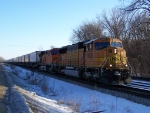 Westbound Piggyback Train Slows to the Mandatory Speed Restriction Before Entering Town