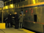 Passengers talk to the conductor about boarding the Capitol Limited