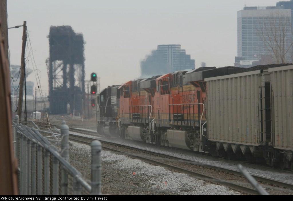 NS 5426 and two BNSF ES44ACs haul a coal train east through CP Drawbridge