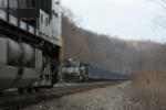 NS 9373 with a coal train off of the OC meets a trash train headed to the OC