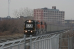 NS 5426 and two BNSF ES44ACs haul a coal train east through CP Drawbridge
