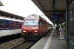 An Intercity-train with an Re 460 is passing Nyon