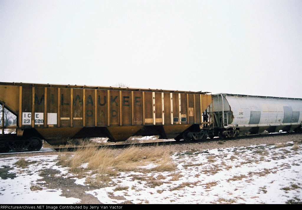 ICE 23620 (ex-MILW) is one of 27 hoppers eb along Hiway 34