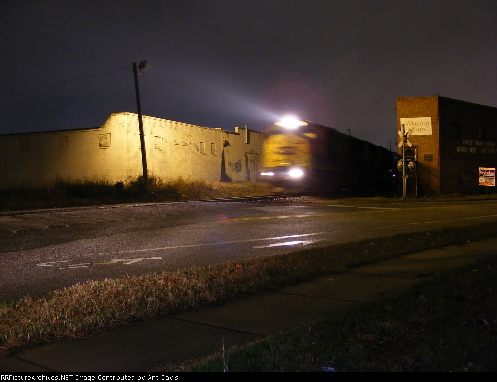 CSX 8740 leads a Mixed Train in between buildings