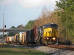Southbound mixed freight briefly manages to dodge the shadows