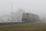 Southbound stacker sails out of the fog and through Folkston.