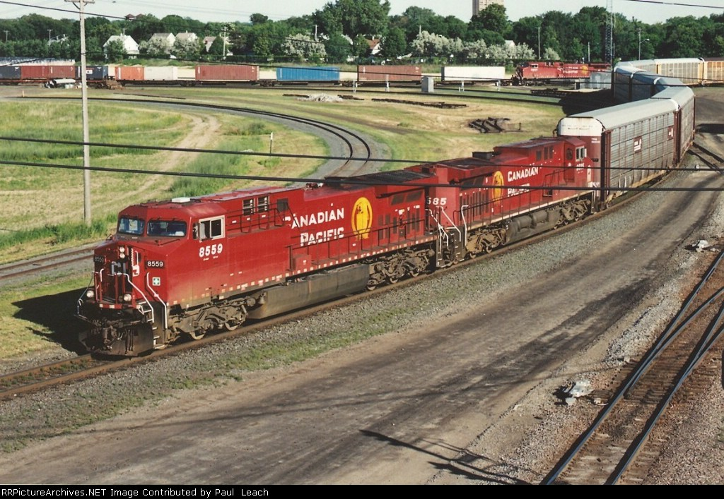 Westbound vehicle train passes University
