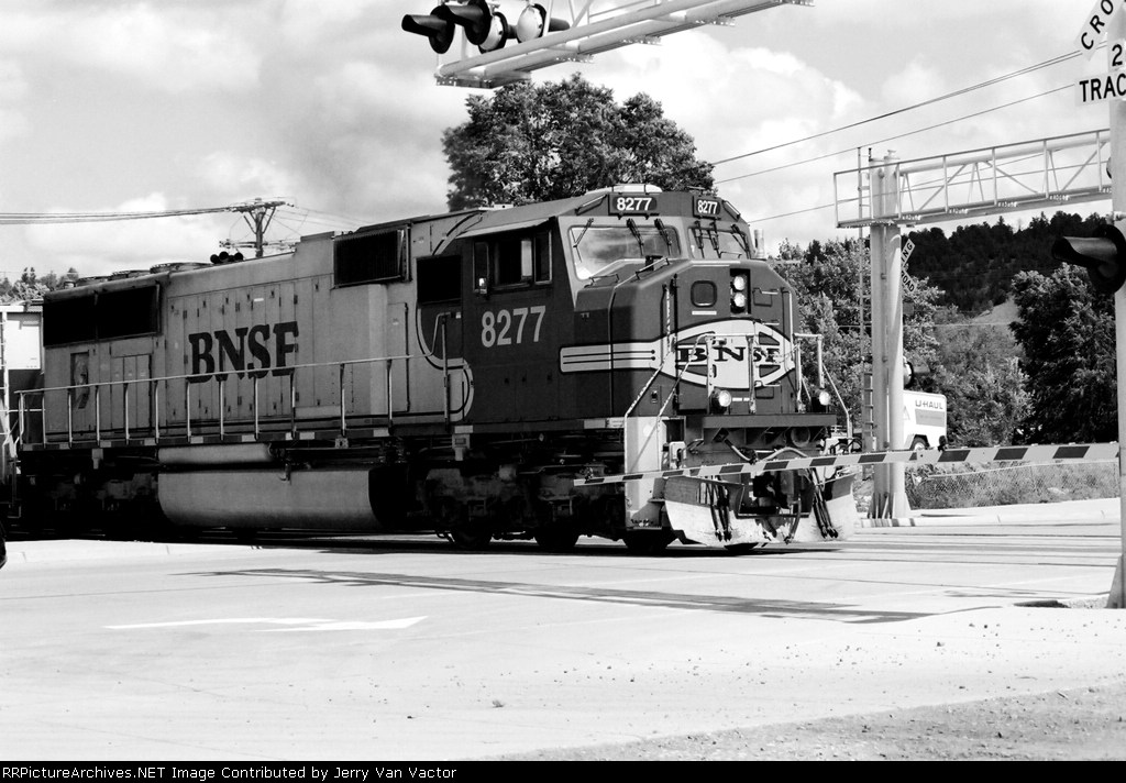 BNSF 8277 waits in the middle of Main St for the switch 50 feet ahead to be thrown