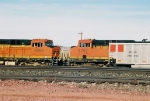 BNSF 6099 and 5797 are waiting for crew while KCLX 306045 and many more KCLX hoppers wait for power