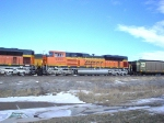 BNSF 9253 is the second power unit waiting with wb coal loads just north of downtown