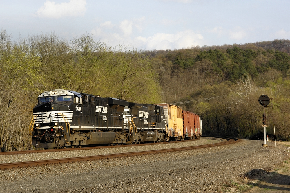 NS 7694 leads a mixed freight past classic PRR signals