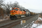 BNSF 6025 with DEEX empties