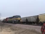 DM&E Train passing some grain cars