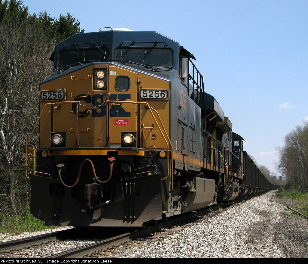 CSX 5256 hustles N912 west with 100 eastern coal loads for West Olive