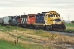 Southbound grain train waits after setting out two units