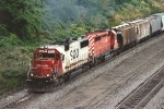 Westbound grain train slogs uphill