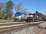 Amtrak Crescent #19 with engineer Big Moe passes stopped freight #173