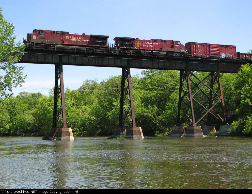 090524032 Westbound CP freight crosses ex-SOO bridge over Crow River