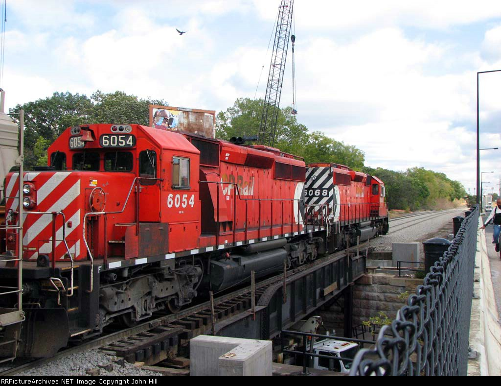 091010058 Eastbound CP freight on BNSF St. Paul Sub. crosses Raymond Ave bridge