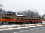 "090303003 Pacing westbound BNSF manifest on newly-opened Hwy 12 ""Bypass"" following relocated Wayzata Sub."