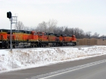 "090303005 Pacing westbound BNSF manifest on newly-opened Hwy 12 ""Bypass"" following relocated Wayzata Sub."