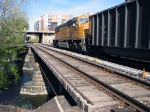 090428019 Westbound WEPX coal empties cross Mississippi River east channel onto Nicollet Island on BNSF Wayzata Sub.