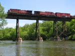 090524032 Westbound CP freight crosses ex-SOO bridge over Crow River