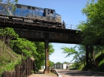 090524047 Eastbound CP freight crosses ex-SOO Line bridge over Maple Street