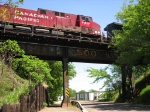 090524048 Eastbound CP freight crosses ex-SOO Line bridge over Maple Street
